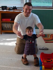 My grandson--David Lee trying to fill his daddy's shoes.
