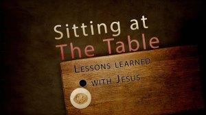 sitting at table main